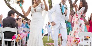 Bride & Groom dancing down the aisle with Sol Maui Event providing ceremony sound services