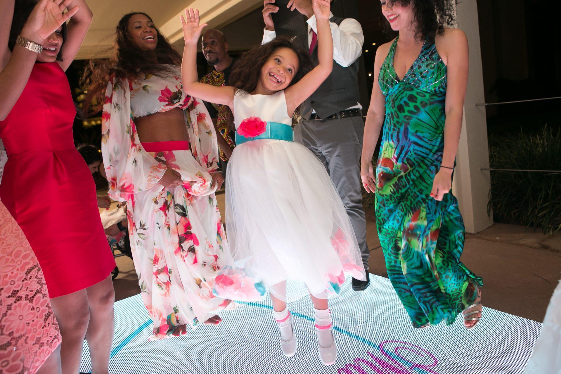 Wedding dancing on a video dance floor